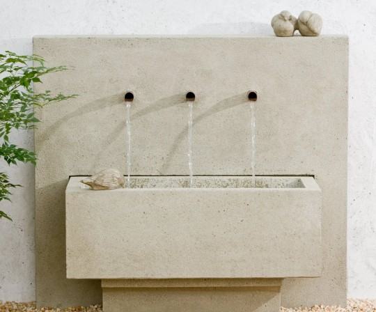 formal fountain with three water spouts into a basin