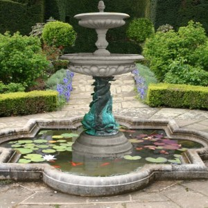 8 ft tall natural fountain with koi fish and water lillies