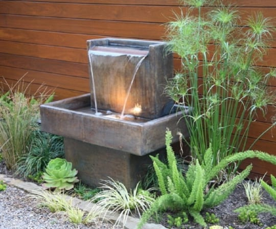 small metal fountain with lights