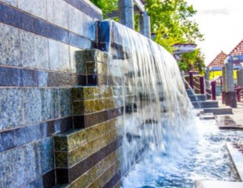 retaining wall waterfall at a local municipal community park