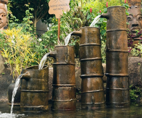 4 tiers of pots with water running down as fountain